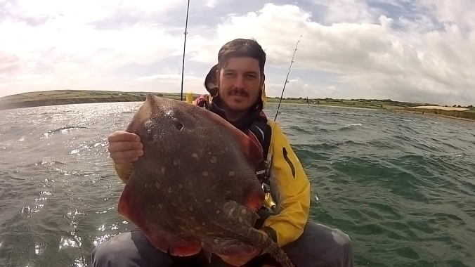 Holding Thornback Ray